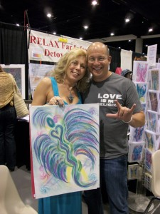 Wisdom of the Angels - Lori Daniel Falk holding angel art